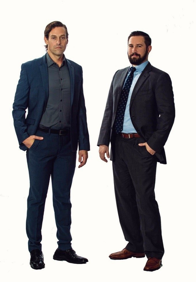 Riverview personal injury lawyers pose at office