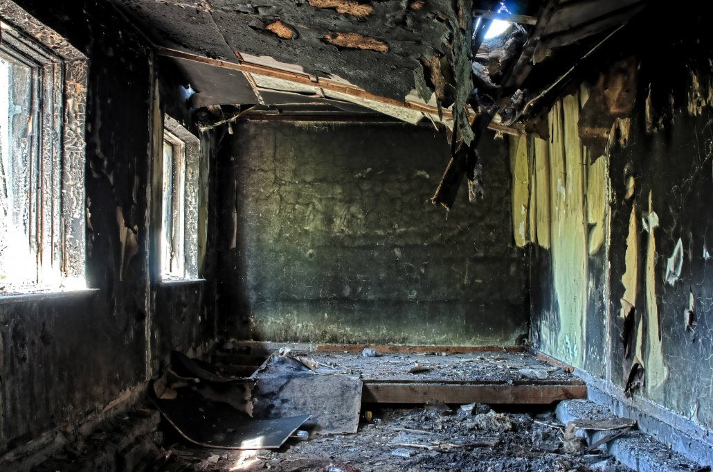 burnt house after a fire that took the life of a young Sarasota girl