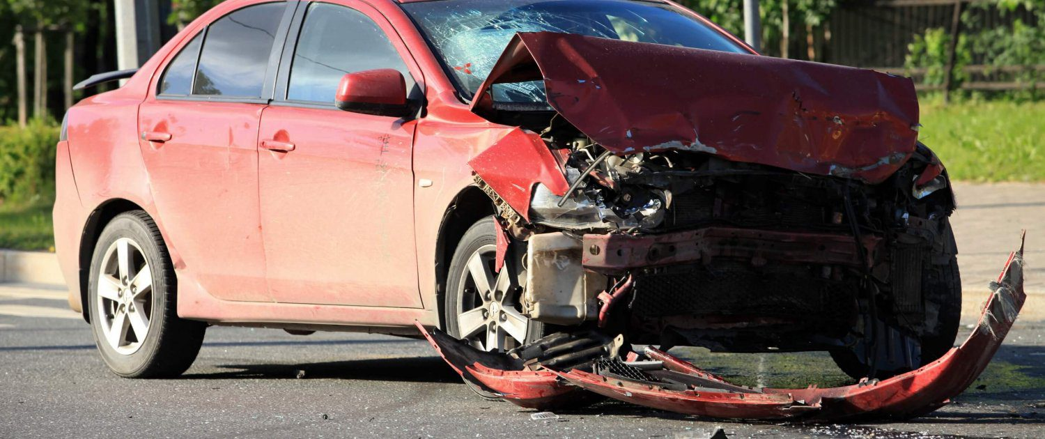 car damaged after a head-on collision