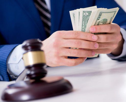 Lawyer distributes money awarded in a personal injury settlement in Florida