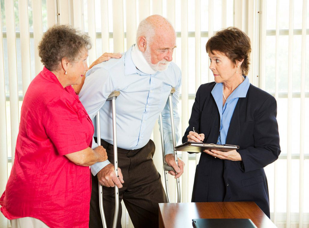 Man discusses a personal injury claim with a personal injury lawyer in Florida.