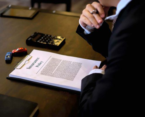 Lawyer discusses denial of auto insurance claim with client in Florida